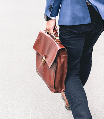 a person carries a briefcase